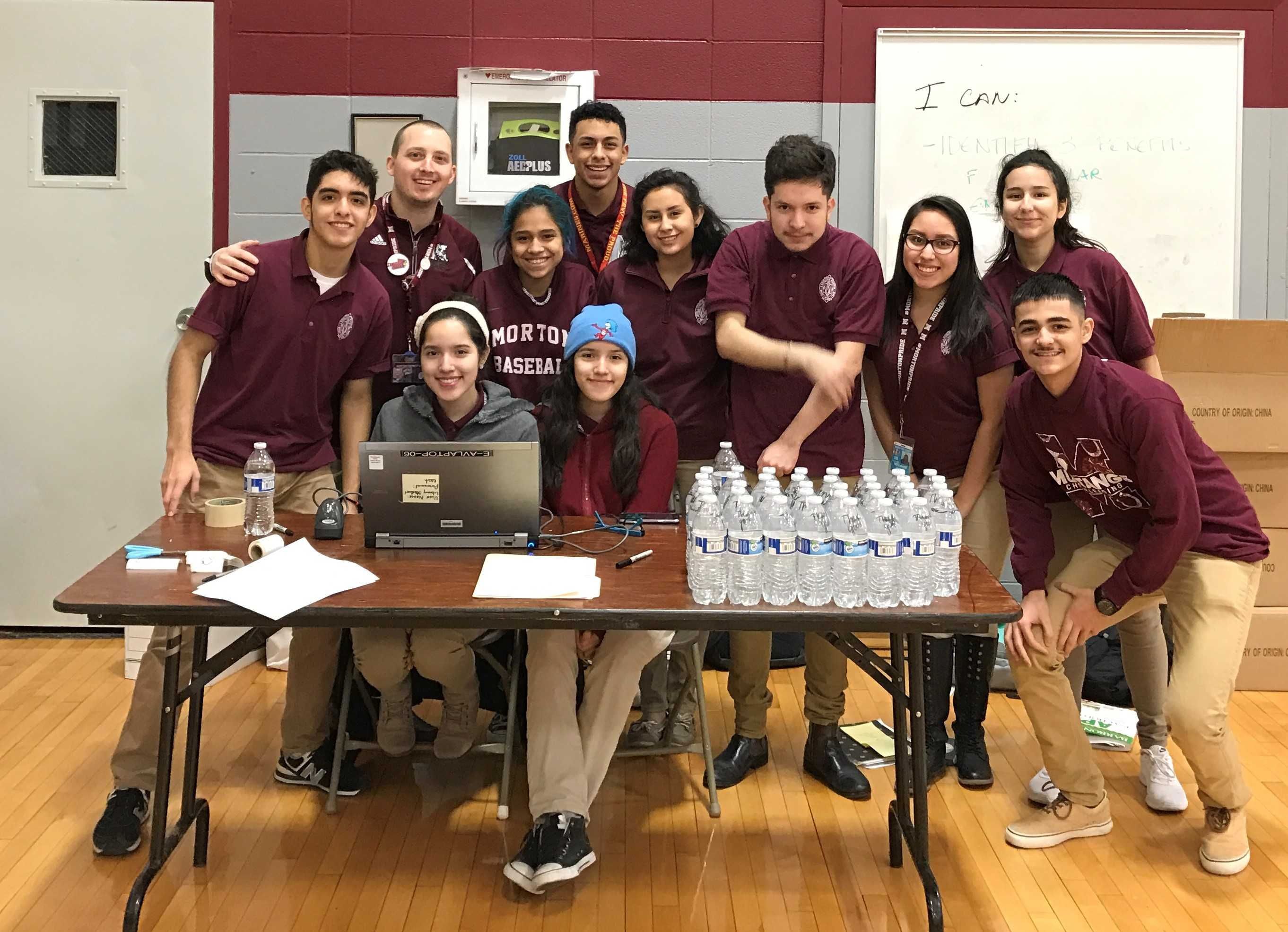 Morton East Snowball (From left to right: Alex Mendoza, Mr. Lunz, Miriam and Mira Maldonado, Imelda Nunos,Tony Marrero, Karol Garfias, Erick Lugano, Melanie Nava, Erick Munoz, Natalia) adding the students for the blood drive procedure.