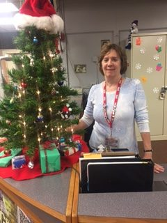 Librarian Mary Ellen Jenicek presents the 2018 Morton Media Center Christmas tree.