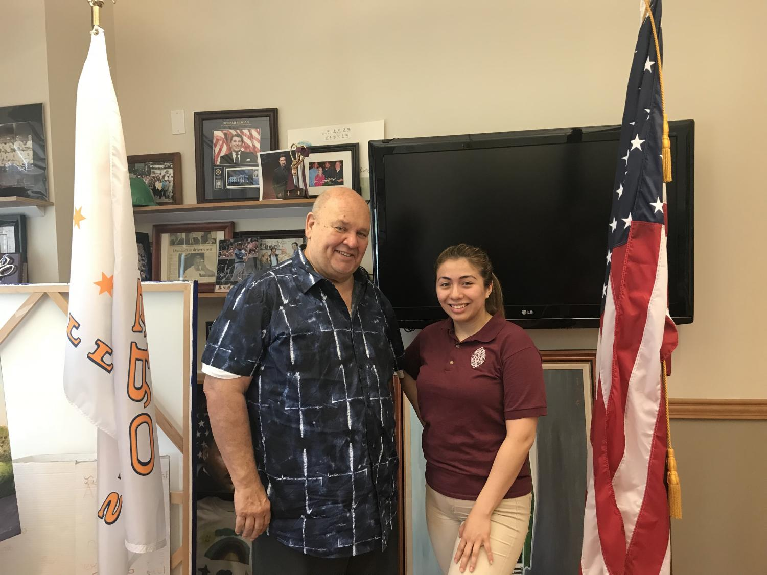 Town of Cicero president Larry Dominick poses with Pony Express News reporter senior Celine Martinez.