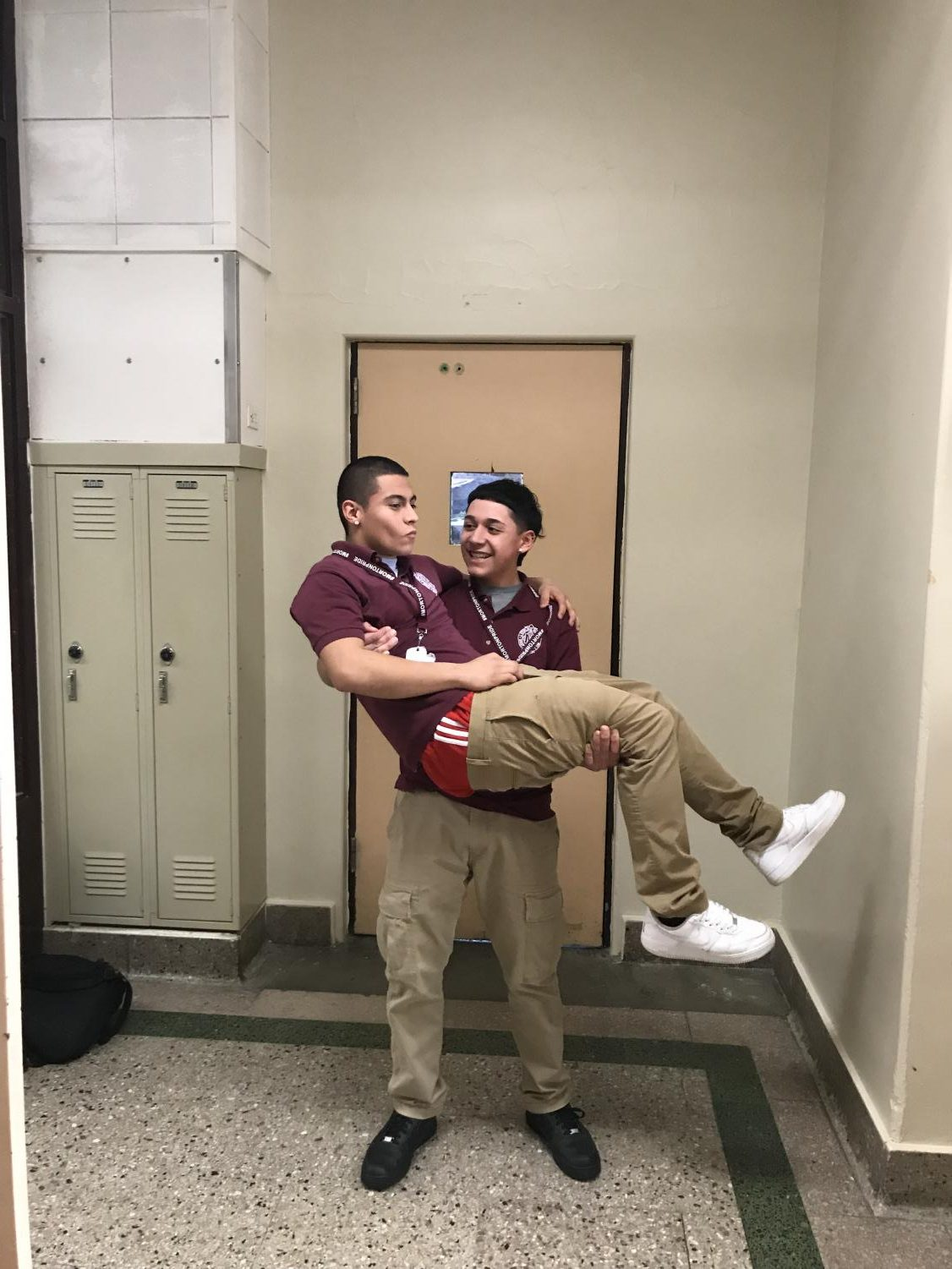 Two senior boys show what it's like to appreciate each other's company.
