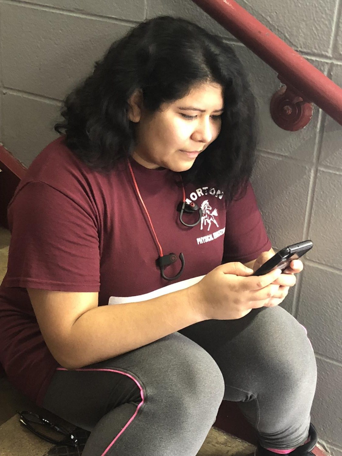 Angelica Vazquez applying for Subway on her phone.