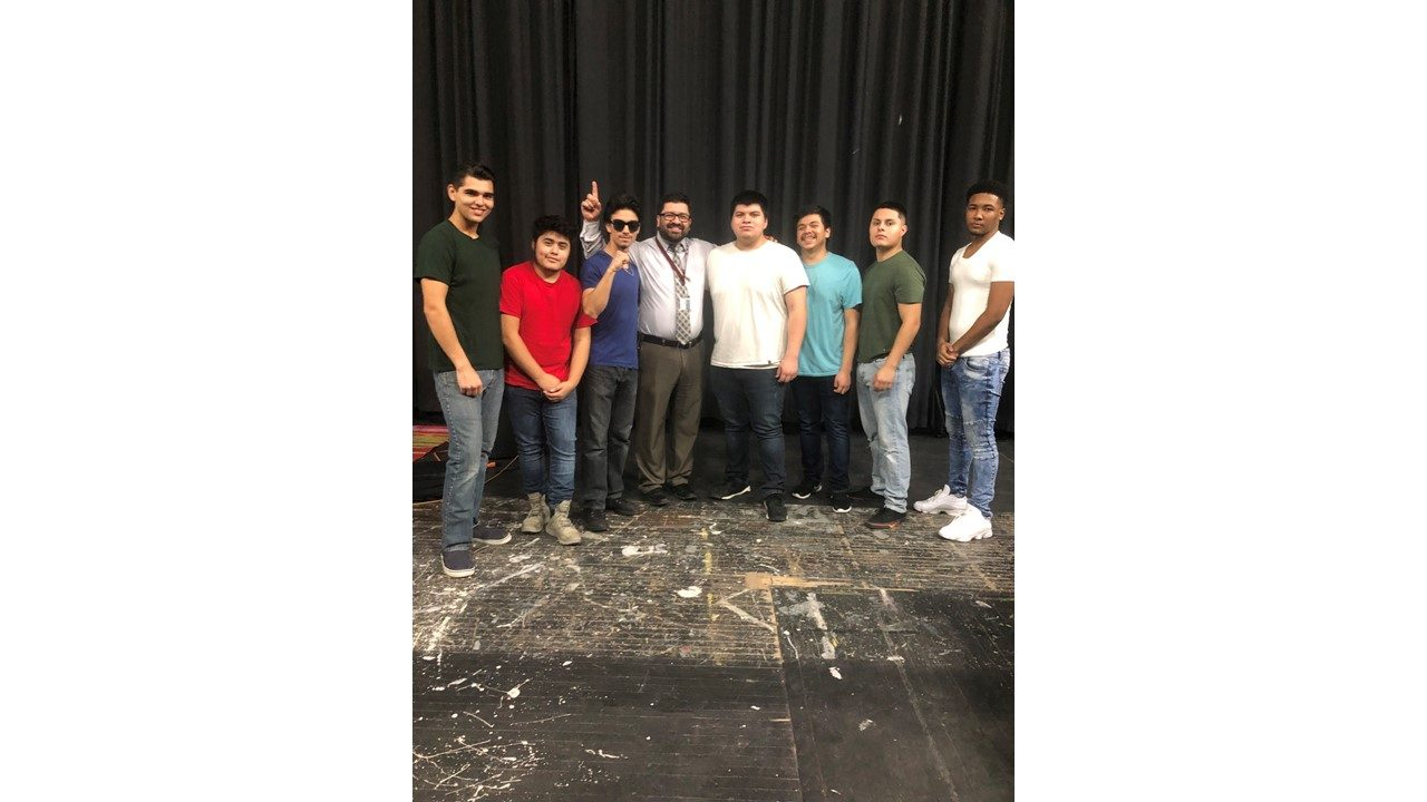 Principal Gamboa stands with the contestants to this year's Mr. Morton East.  Contestants include (left to right)  Gavin Salas, Angel Mendez, Luis Ballesteros Ricardo Salgado, Irving Recillas, Eddie Arias, and Iberus Jenkins.