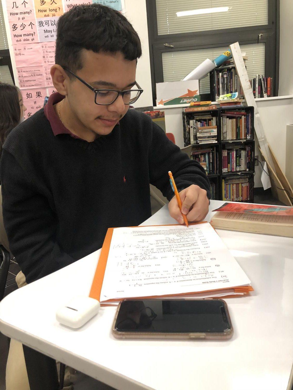 Senior Lauro Gonzalez is doing his work.