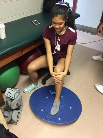 Junior Adrianne Bungubung sprained her ankle and is doing her exercises to become stronger and get back on the volleyball court.