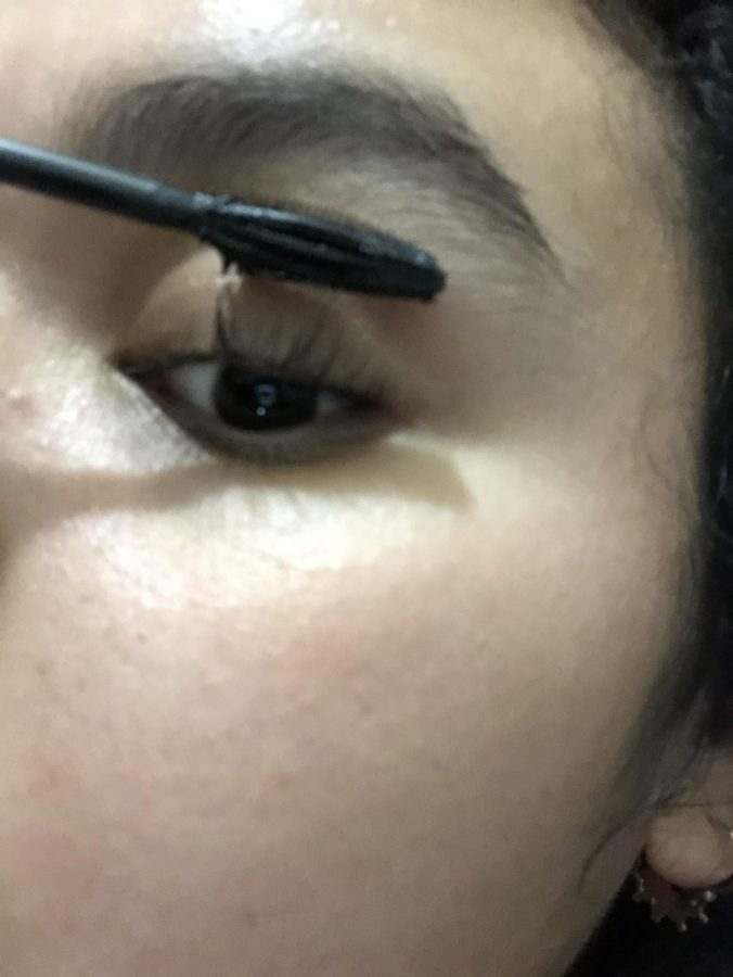 Adding your mascara… Senior Evelyn applies a thin layer of mascara to have a natural look. Looking straight forward, apply it to the top lash with upward strokes. Start with the inner part of your eye and work your way outward. A good trick for making your lashes look fuller is to apply a coat of baby powder between coats of mascara. This will add a bit of length and volume to your lashes. In a recent survey reported by Makeup research, 104.72 million women in the U.S, used mascara in 2019. (Luzedith Ornelas)