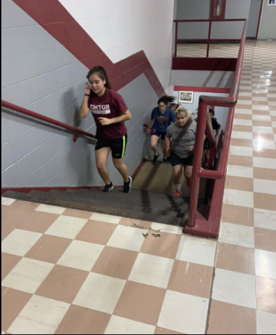 RUNNING STAIRS...Senior Paola Masias exercises during Coach Tovar