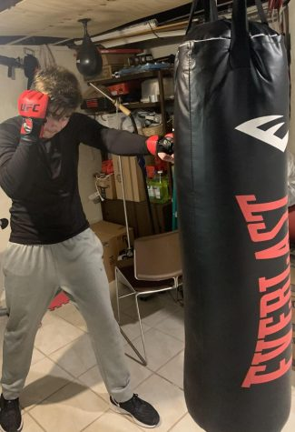 Morton student Gerardo Vazquez was hitting the heavy bag with UFC fight gloves.
