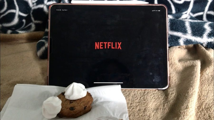 Netflix on a tablet with cookies to the left.