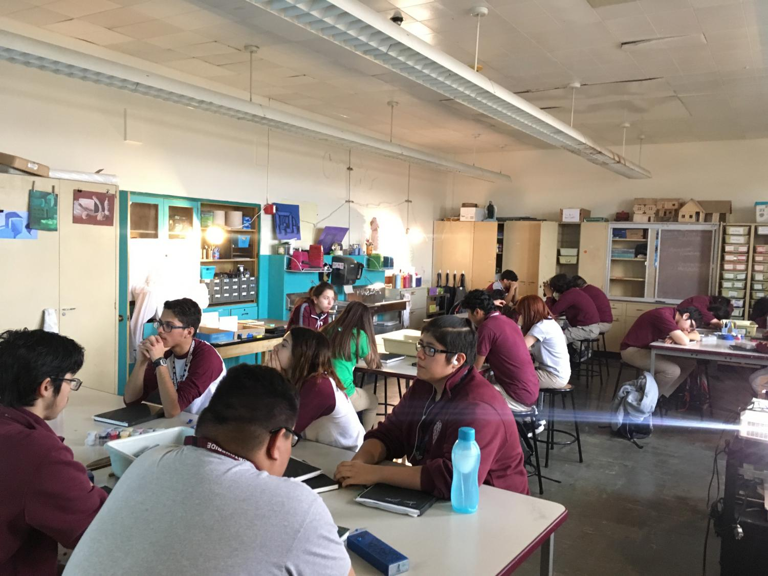 A class of students meditating to release stress and calm their minds.