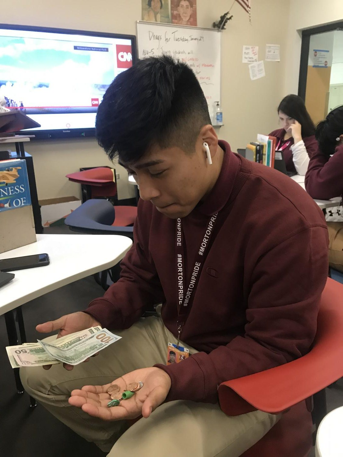 Senior Kevin Castillo counts  his cash prior to a big shopping spree he has planned.