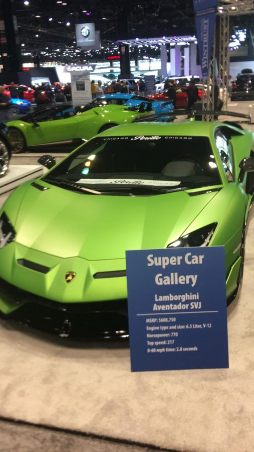 LAMBO%E2%80%A6+Rich+People+need+a+ride%2C+and+don%E2%80%99t+know+what+to+do+with+their+money%3B+this+Lamborghini+can+help.+It+appeared+at+the+Chicago+Auto+Show%2C+February+8+through+February+17.++