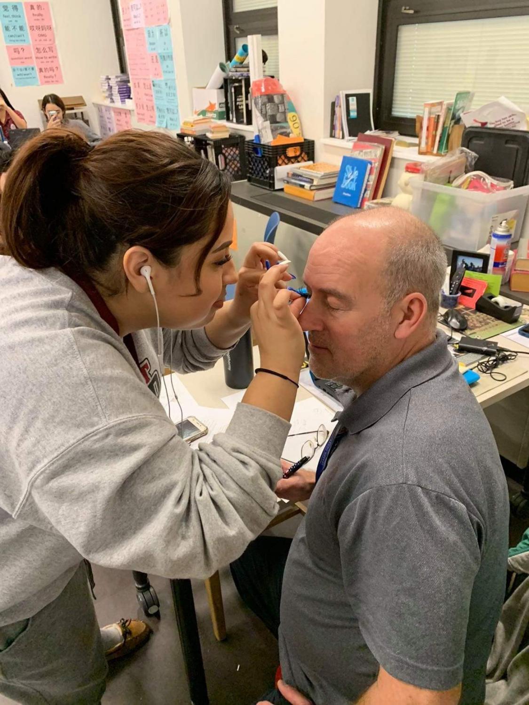 Putting fake eyelashes on Mr. Frankfother