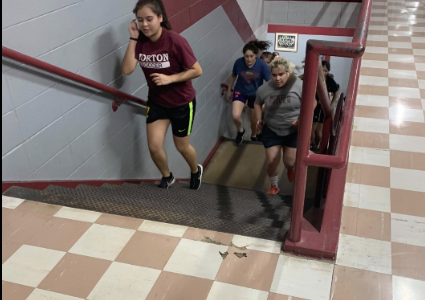 RUNNING STAIRS...Senior Paola Masias exercises during Coach Tovar's JV practice. JV does a run for 20-30 minutes at least each practice. Everyone puts in hard work and participates to get fit before upcoming games. (Paola Masias)