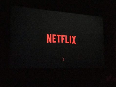 70inch Tv Displaying A  Netflix Logo Running at 8k