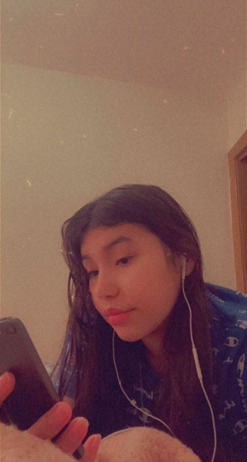 Marissa Bravo is listening to blinding lights on her phone