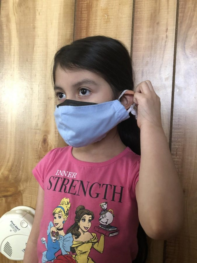 Jailene Velazquez wears her double masks.