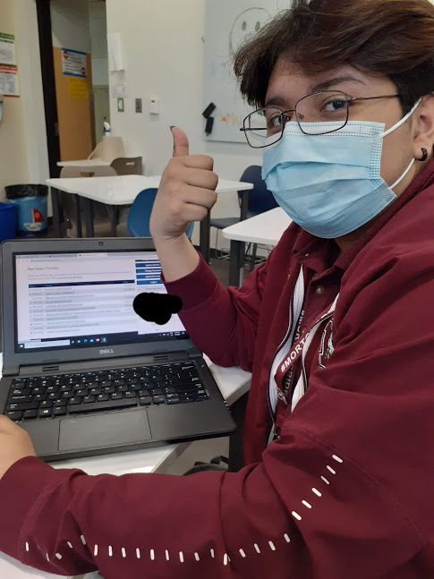 Ivan Olivares is  making sure important information is filled out before he starts his fall semester this year at Depaul.